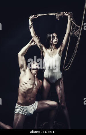Circus gymnasts at pilates or yoga training. Fitness dieting and flexibility in acrobatics. Sport workout for couple in love. couple of man with - Stock Photo