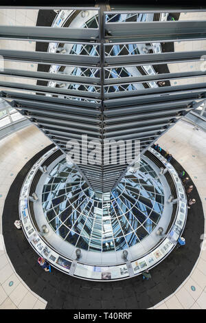 High-angle view of mirrored cone and interior of the futuristic glass dome on top of the Reichstag (German parliament) building in Berlin, Germany. - Stock Photo