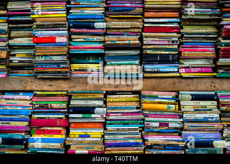 Spines of used books are seen stacked in shelves in a secondhand bookshop in San Salvador, El Salvador. - Stock Photo