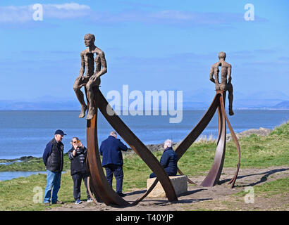 Visitors at 'Ship', metal sculpture by Anna Gillespie, 2019. Half Moon Bay, Heysham, Lancashire, England, United Kingdom, Europe. - Stock Photo