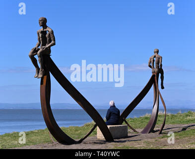 Visitor at 'Ship', metal sculpture by Anna Gillespie, 2019. Half Moon Bay, Heysham, Lancashire, England, United Kingdom, Europe. - Stock Photo