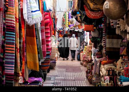 Two women walking around the souk in Essaouira, Morocco - Stock Photo