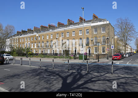 Elegant terrace of Georgian houses on Bow Road in London's East End, UK. Corner of Tredegar Square. Most now converted to flats. - Stock Photo