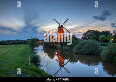 Two windmills in Greetsiel at the blue hour - Stock Photo