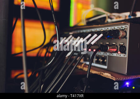 Audio jack cable connected at rear end of mixer at broadcasting,shallow depth of field. - Stock Photo
