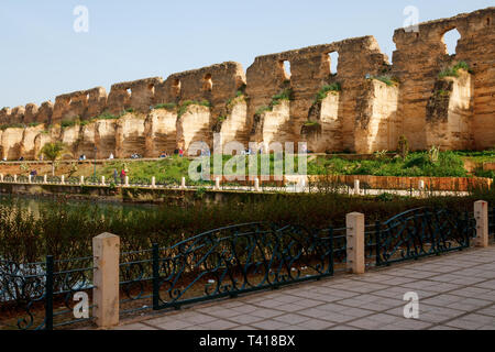 Heri es-Souani wall with large buttresses. It was an ancient architectural master piece and served as granary and stables. Meknes, Morocco. - Stock Photo