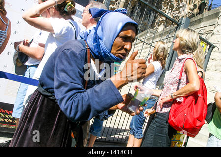 Gipsy beggar, Sagrada Familia cathedral, Barcelona, Catalonia, Spain - Stock Photo