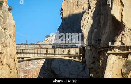 Visitors on the El Caminito del Rey or The King´s Walkway. The walkway is built into the side of the gorge of El Chorro in the Desfiladero De Los Gait - Stock Photo