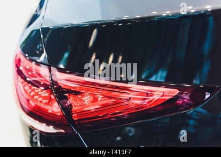 Back view of new black car. Closeup headlights of car. Black premium city crossover, luxury SUV rear light closeup. Car lamp close-up. - Stock Photo