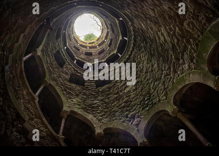 One of the 'Initiation' wells or inverted towers in the grounds of the Quinta da Regaleira in Sintra, Portugal - Stock Photo