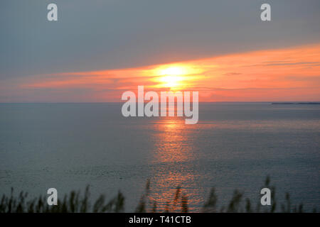 Sunset from the Gay Head cliffs of clay at the westernmost point of Martha's Vineyard in Aquinnah, Massachusetts, USA. - Stock Photo