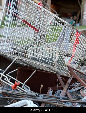 old broken shopping cart in recycling ecocenter - Stock Photo