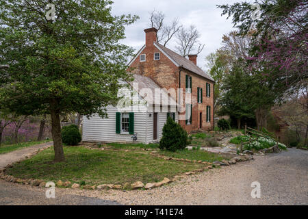 Historic red brick house on the grounds of Colvin Run Mill in Great Falls, VA, USA. - Stock Photo