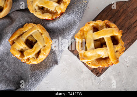 small apple pies on the table, top view - Stock Photo