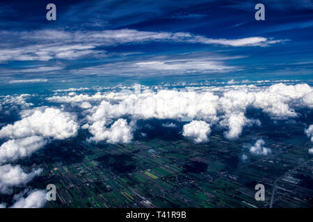 This unique photo shows the magnificent German landscape with villages and fields. The picture also shows the cloud cover as it was taken out of plane - Stock Photo
