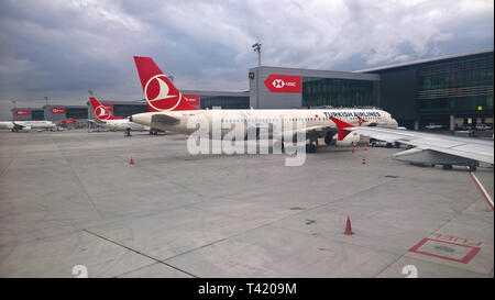Exterior view of the terminals at the new mega airport in Istanbul, Turkey, few days after opening - seen from aboard a Turkish Airlines airplane - Stock Photo