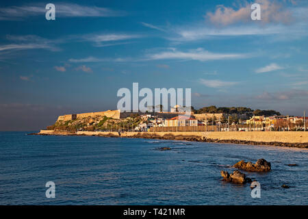 View of Fortezza, the castle of Rethimno town, late in the afternoon. Crete island, Greece. - Stock Photo