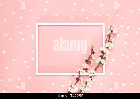 Flowers composition creative. Blank photo frame, pink flowers on living coral background, Copy space. - Stock Photo