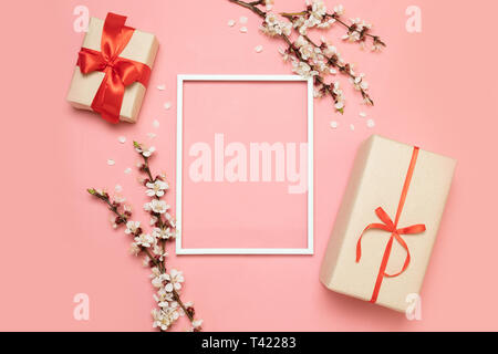 Blank frame for text, pink flowers with gift box on pink background. - Stock Photo