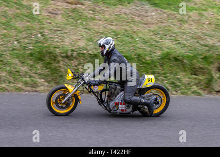 Chorley, Lancashire, UK. April, 2019. Hoghton Tower 43rd Motorcycle Sprint. Rider 91 David Brown from Bolton riding a old 1984 50cc Weslake slip up. - Stock Photo