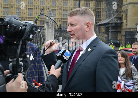 London, UK. 12th Apr 2019. Paul Golding Leader of Britain First was in Parliament square to greet the thousands of bikers who descended in parliament today to protest against the British Government for The Bloody Sunday prosecution of a British Soldier - Stock Photo
