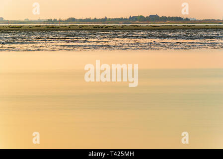 summer twilight over the coastline inside the lagoon in Bibione, Venice - Stock Photo