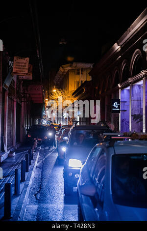 Athens, Greece - 26 Mar 2016: Traffic jam on the Athinaidos  street in central Athens near Monastiraki square with rows of cars waiting in line at night  - Stock Photo