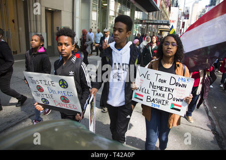 4/6/19: Days before Sudan's dictatorial president Omar al-Bashir was forced from office by a military coup, Sudanese Americans and immigrants demonstrate and march to the UN in NY City to have Bashir resign immediately from office and have democracy restored i9n Sudan. - Stock Photo