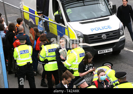 Manchester, UK. 12th Apr 2019. Police Officers issue dispersal orders to young people who had been taking part in climate change action on the city streets. Some of the young people had taken part in sit down protests blocking commuter routes. Manchester, UK, 12th April 2019 Credit: Barbara Cook/Alamy Live News - Stock Photo