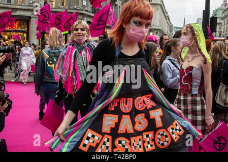 London, UK. 12th Apr, 2019. Extinction Rebellion close Oxford Circus by laying a pink carpet down and performing a fashion show to highlight the fashion industry's role in climate change. Credit: Claire Doherty/Alamy Live News - Stock Photo