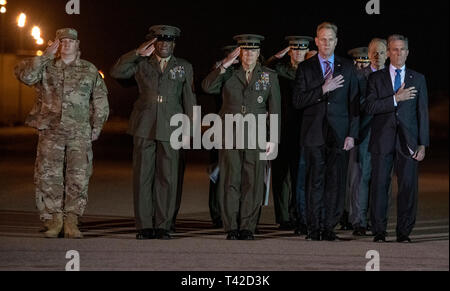 Front row, from left to right: United States Air Force Colonel Matthew Jones, 436th Airlift Wing, Vice Commander; Sergeant Major of the US Marine Corps Ronald Green; US Marine Corps General Robert B. Neller, Commandant of the Marine Corps; Acting United States Secretary of Defense Patrick M. Shanahan; and Governor John Carney (Democrat of Delaware); and US Senator Tom Carper (Democrat of Delaware), salute as a US Marine Corps carry team participates in the Dignified Transfer of the transfer case containing the remains of US Marine Corps Staff Sergeant Christopher A. Slutman at Dover Air Force  - Stock Photo