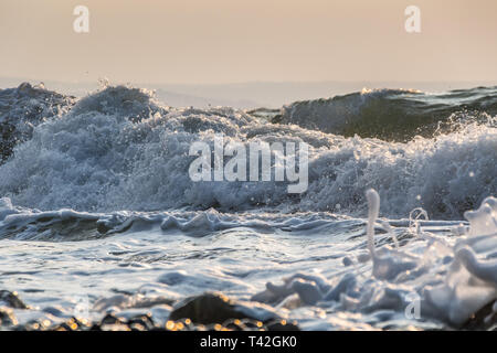 Mousehole, Cornwall, UK. 13th Apr, 2019. UK Weather. Cold winds from the East approaching 50 mph are starting to hit the coast of Cornwall. Credit: Simon Maycock/Alamy Live News - Stock Photo