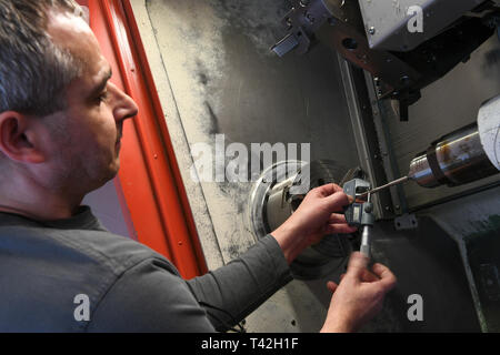 Kassel, Germany. 05th Apr, 2019. Thomas Neumann carries out a tensile compression test on a CNC lathe as a material test in the mechanical workshop of the University of Kassel. The university workshops are indispensable for researchers at Hessen's universities. What the scientists need for their experiments is usually not available in any DIY store. Credit: Uwe Zucchi/dpa/Alamy Live News - Stock Photo