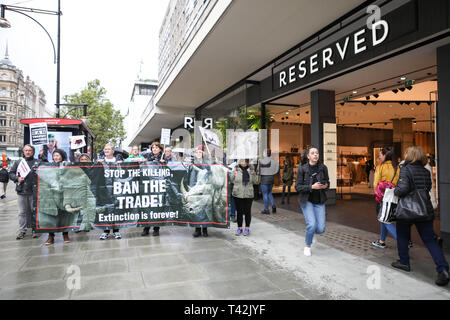 London, UK. 13th April, 2019. The 5th Global March for Elephants and Rhinos march from Cavendish Square to Downing Street for a day of action against trophy hunting and endangered wildlife. Penelope Barritt/Alamy Live News - Stock Photo