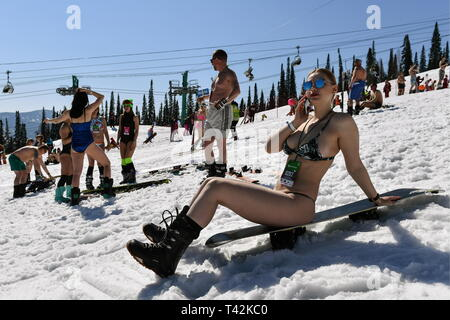 Russia. 13th Apr, 2019. KEMEROVO REGION, RUSSIA - APRIL 13, 2019: Skiers and snowboarders in swimwear during the Grelka Fest-2019 Festival at the Sheregesh ski resort. Kirill Kukhmar/TASS Credit: ITAR-TASS News Agency/Alamy Live News - Stock Photo