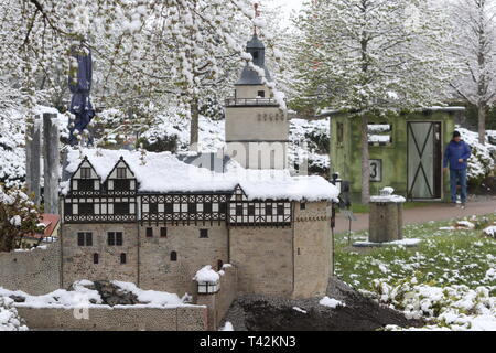 Wernigerode, Germany. 13th Apr, 2019. The model of Falkenstein Castle in the miniature park 'Kleiner Harz' is snow-covered. The miniature park 'Kleiner Harz' celebrates its tenth birthday and the season opening on 13.04.2019. Around 60 sights of the Harz Mountains have been reproduced on a scale of 1:25 and are presented on the 1.5 hectare site. Credit: Matthias Bein/dpa-Zentralbild/ZB/dpa/Alamy Live News - Stock Photo