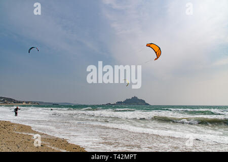 Marazion, Cornwall, UK. 13th April 2019. UK Weather.  Windsurfer and Kitesurfers were out in force on the sea at Marazion, making the most of the very windy conditions. Credit: Simon Maycock/Alamy Live News - Stock Photo