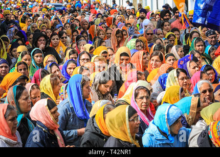 Gravesend, Kent, UK, 13th April 2019. Thousands of spectators and religious visitors line the streets of Gravesend in Kent to watch and participate in the annual Vaisakhi procession. Vaisakhi is celebrated by the Sikh community all over the world. - Stock Photo