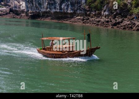 A sailing junk boat in Halong Bay, Vietnam - Stock Photo