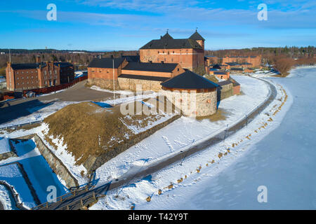 View of the ancient fortress on a sunny March day (aerial survey). Hameenlinna, Finland - Stock Photo