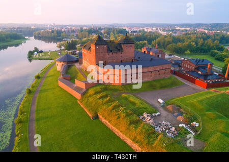 The ancient fortress against the background of the urban landscape in the early July morning (shooting from a quadrocopter). Hameenlinna, Finland - Stock Photo