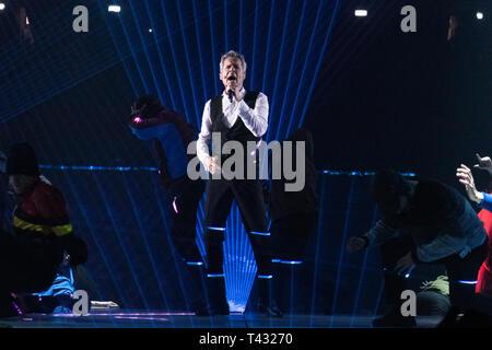 Milan, Italy. April 12, 2019. Claudio Baglioni sings on stage during his Italian Tour - Stock Photo