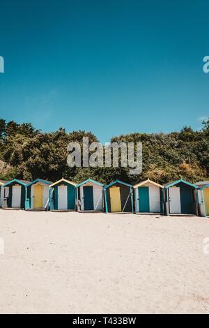 A row of beach huts in Swanpool beach, Falmouth, Cornwall - Stock Photo