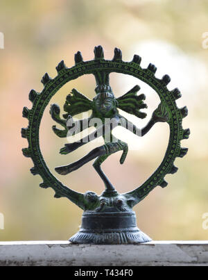 Front view of a bronze statuette of the dancing Shiva - Nataraja, with patinated egdes - Stock Photo