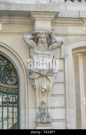 Facade atlante of Real Academia Nacional de Medicina building. Built in 1912 by Luis Maria Cabello Lapiedra. Located in Arrieta Street, Madrid, Spain - Stock Photo
