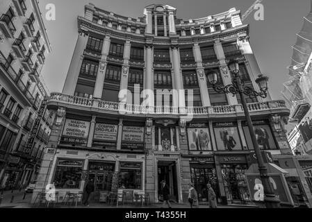 Madrid, Spain. January 9, 2017. Street  level view of Plaza Canalejas historic buildings and Calle de la Cruz. - Stock Photo