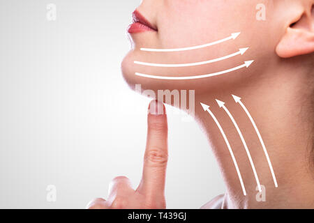 Woman With Arrows On Her Face Over White Background - Stock Photo