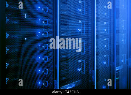 Web network, internet telecommunication technology, big data storage, cloud computing computer service business concept: server room interior in datac - Stock Photo