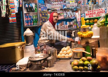Horizontal view of lassi being made at a juice stall in Kolkata aka Calcutta, India. - Stock Photo