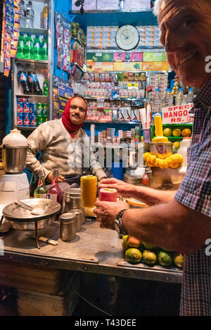 Vertical view of lassi being made at a juice stall in Kolkata aka Calcutta, India. - Stock Photo